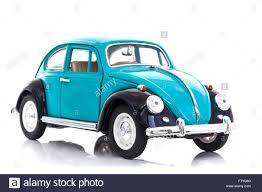 volkswagen beetle blue old blue die cast vw beetle model on a white background stock