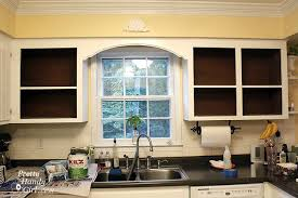 how to clean inside of cabinets fabric backed open kitchen cabinets diy on a dime the
