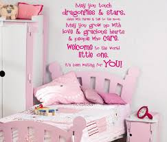 white toddler room wall with pink wooden bed and pink wooden