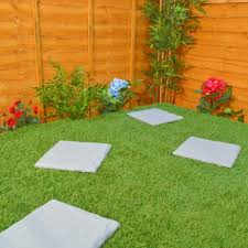 backyard flagstone patio ideas with nice flowers and graas and