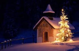 chapel with christmas tree and snow elmau bavaria germany europ