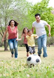 Kids Playing Backyard Football Happy Family Playing Soccer And Running Towards The Camera In The