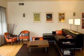 Orange Living Room Set Black Sofa And Square Brown Wooden Table On The Black Rug Combined