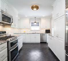 white kitchen cabinets black tile floor white kitchen cabinets with black and gray granite