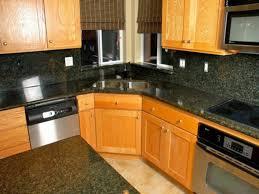 granite countertop kitchen cabinets lighting gray backsplash