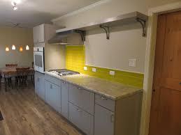 yellow glass subway tile kitchen backsplash with pop subway