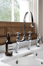 kitchen bridge faucet devol kitchens devol kitchen bridge faucet with offset legs and a