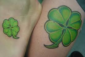 nice four leaf clover tattoo on left back shoulder