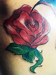 bleeding hearts and flowers sketch tattoo design tattoomagz