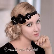roaring 20 s fashion hair glamorous curly updo hairstyle inspired by great gatsby 20s