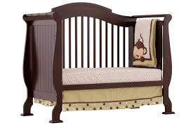 decorating charming brown wooden crib with dotted bedding by