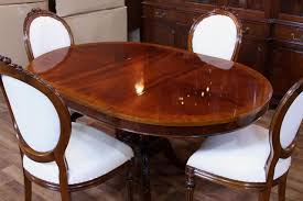 pedestal style mahogany dining table with