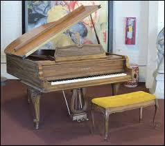 carved oak baby grand piano