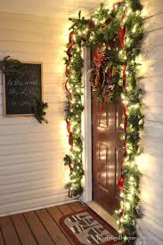 Christmas Decorations For Outside Door by Our Christmas Front Porch With Hanging Candle Lanterns