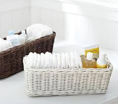 chagne baskets use baskets to organize diapering on changing table and around