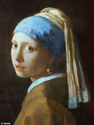 vermeer the girl with the pearl earring painting banksy s version of girl with a pearl earring appears on bristol