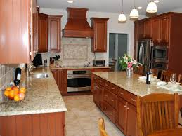 traditional kitchen backsplash designer helen richardson uses warm wooden cabinetry and granite