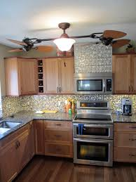a kitchen remodel 7 tile backsplash and faux textured tin surface