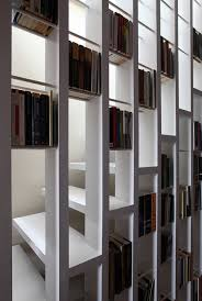 stair bookcase stairs double as bookcase in loft conversion by tamir addadi