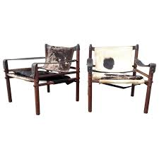 pair of arne norell sirocco chairs in rosewood and cow hide cow