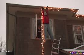 people who hang christmas lights people call 911 after seeing dummy hanging christmas lights