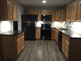 what color cabinets look with black stainless steel appliances hickory cabinets black stainless appliances black