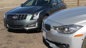 cadillac ats vs bmw cadillac ats 2 0t vs bmw 335i mashup 0 60 mph performance test