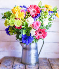 Image Of Spring Flowers by Colorful Bouquet Of Spring Flowers In Vintage Vase On Rustic