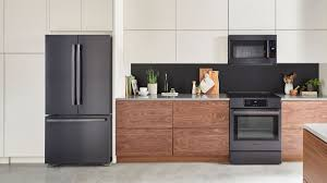 what color cabinets match black stainless steel appliances tips for venturing beyond stainless steel in the kitchen