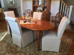 carrington court in your home customer photos the fall centerpiece looks lovely with the scroll back dining chairs with kick pleat skirts