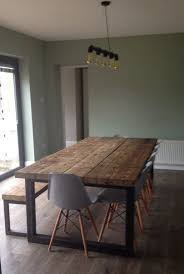 Wooden Dining Room Furniture This Wooden Dining Table Is Accented The Metal Bands Pertaining To