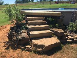 rock step entry for an above ground pool backyard oasis
