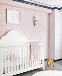 pink nursery wallpaper with white french crib transitional nursery
