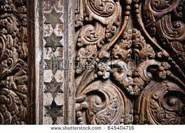 beautiful wood carving on ancient door stock photo 645404716