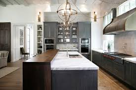 gray kitchen island with walnut waterfall breakfast bar