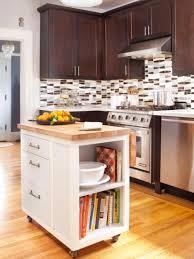 simple kitchen design with brown kitchen island metallic hood