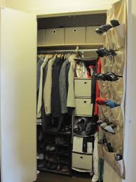 small walk in closet with hamging shoe storage and drawers plus
