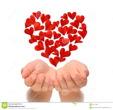 hearts in heart shape flying over cupped hands of young woman