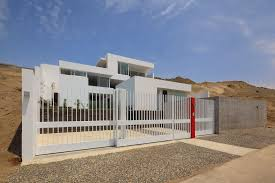 chic black iron gate and concrete fence as modern design