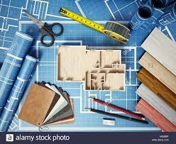 home decorating tools home decorating tools standing on house bluprints 3d illustration