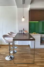 space saving kitchen design wooden dining table classy white counter stool apartment small