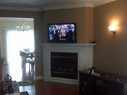 Tv Mount Over Fireplace by Furniture Corner Tv Mounted Over White Fireplace As Well As