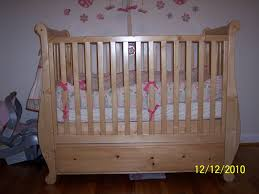 bedroom natural wood sleigh crib design for your traditional baby