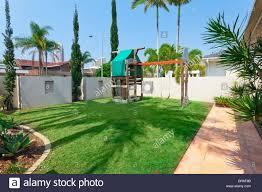 kids playground in modern australian backyard stock photo royalty