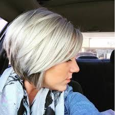 blonde bobbed hair with dark underneath platinum with a hint of dark highlights underneath hairdos