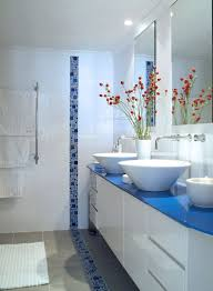 love the color blue in this bathroom contrasting with the white