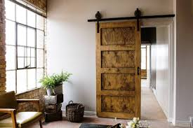 Wooden Barn Door by Interior Natural Wooden Barn Door Matched With Bricks House
