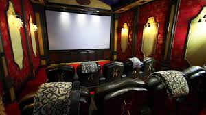 interior outsize home theatre designs with orange bean chair and