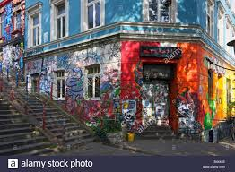 shop apartments graffiti and wall art cover a shop and apartments in the st pauli