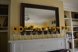 bridal shower decor for the love of felt i am obsessed with how simple the arrangement is the trick is owning 11 bud vases that can support the weight of a sunflower if you re like me and do not